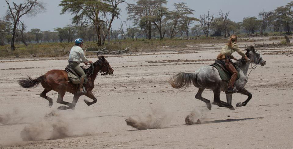 Jo and Bob racing, Kaskazi Horse Safaris