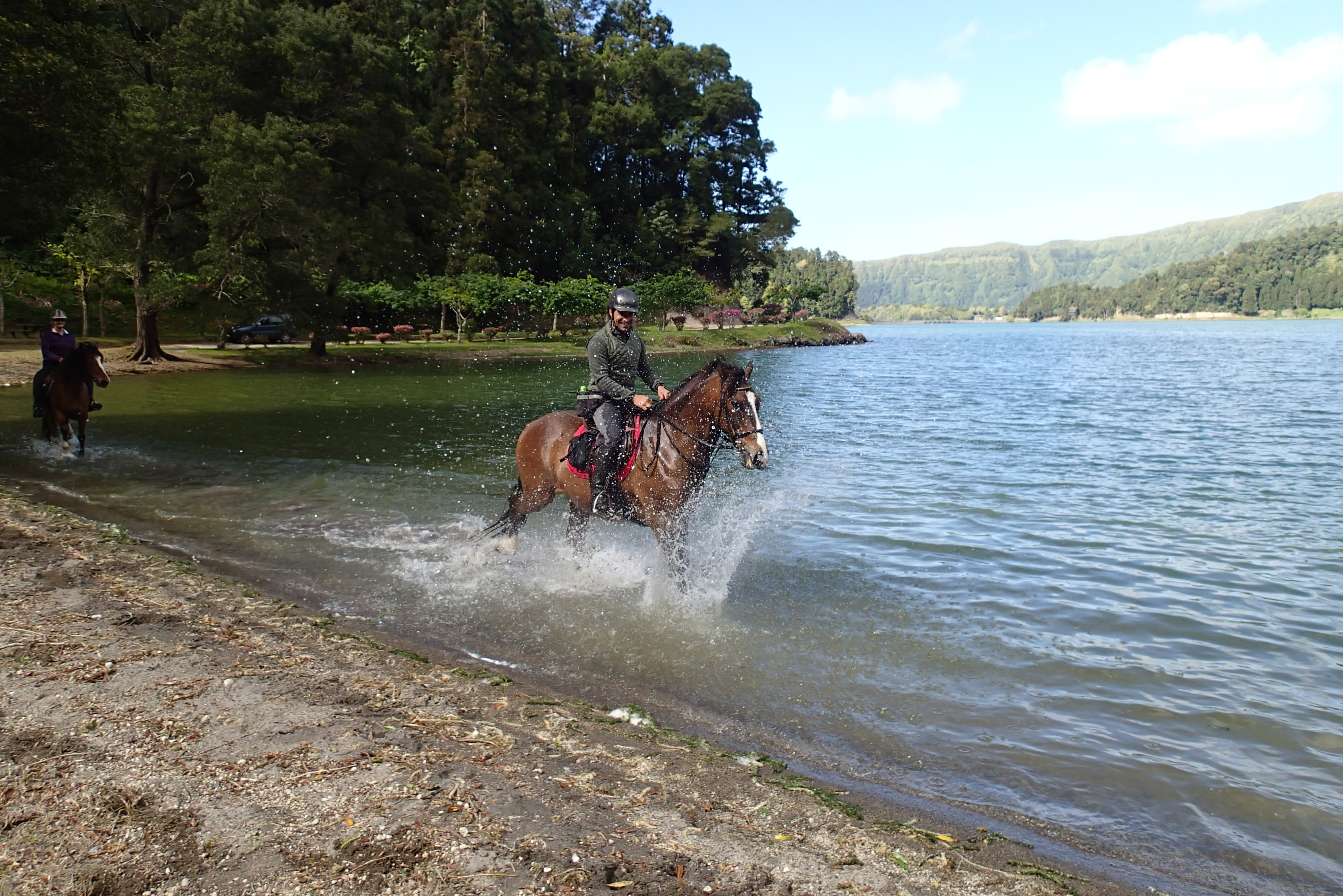 splashing along the lake shore in the azores