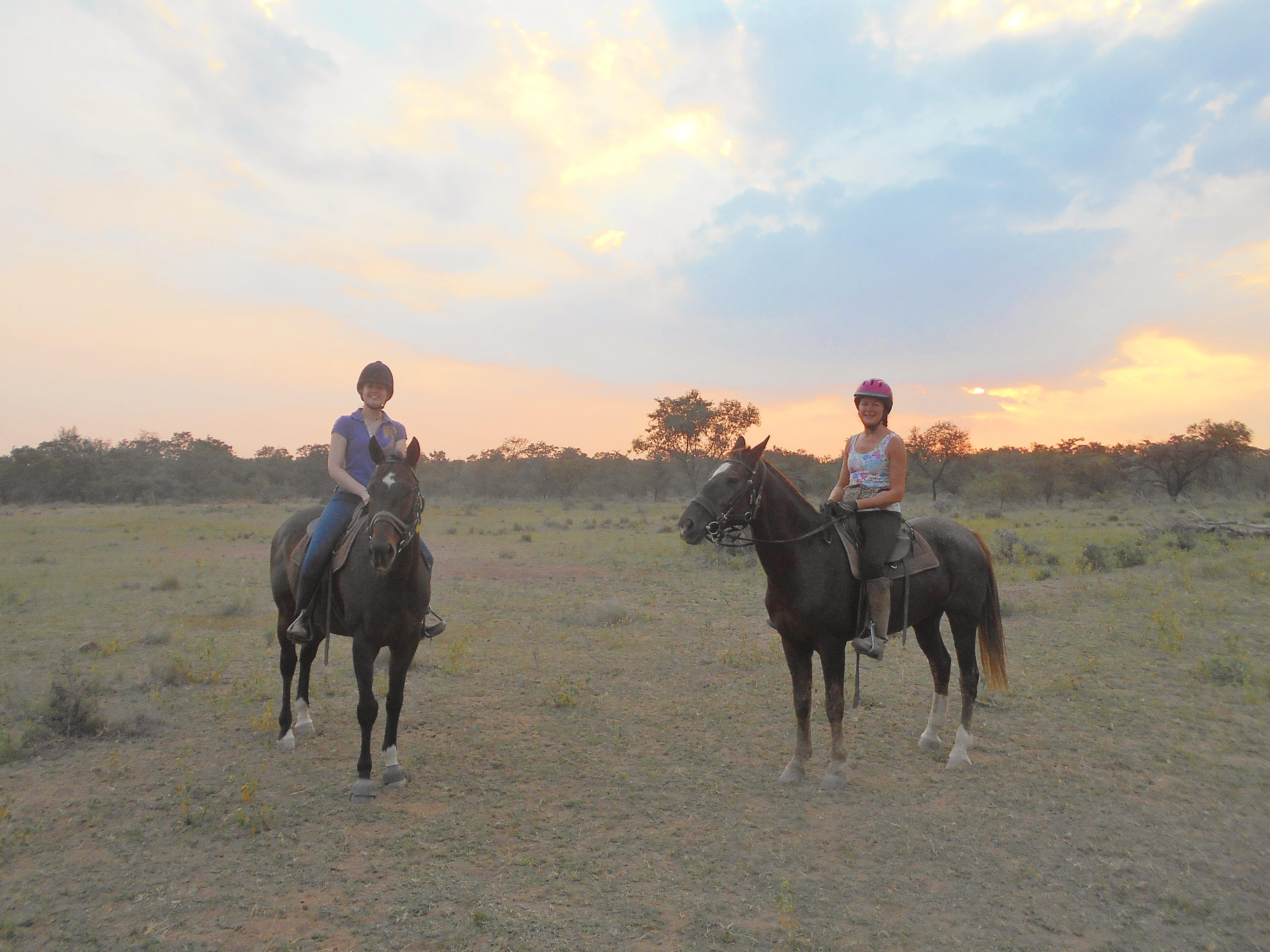 On horseback as the sun begins to dip towards the horizon