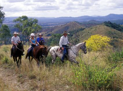 Riding horses through the mountains in Australia on a riding holidays with In The Saddle