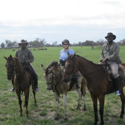 In The Saddle. Riding Safari at Macatoo, Okavango Delta, Botswana. Horses, guests and guide