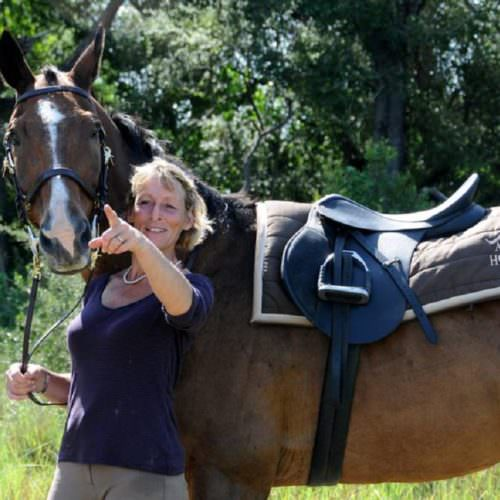 In The Saddle. Riding Safari Holiday at Macatoo, Okavango Delta, Botswana. Mary King,