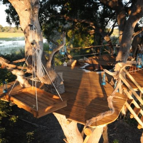 In The Saddle. Riding Safari at Macatoo, Okavango Delta, Botswana. Tree house.