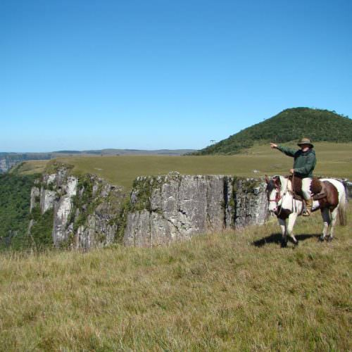 Riding Holidays in Brazil. Trail riding vacation. Horse riding by canyon.