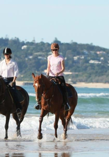 Riding on the beach at Noosa - Queensland, Australia