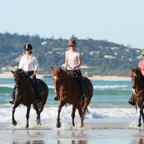 Riding on the beach at Noosa - Queensland, Australia