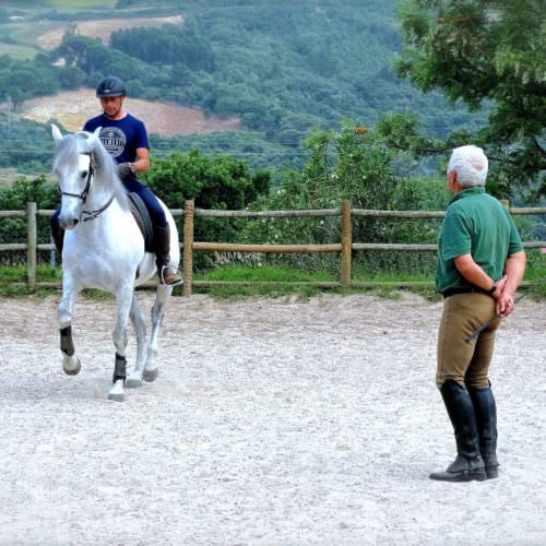 Head instructor Georges teaching a student to Piaffe on Xissano.
