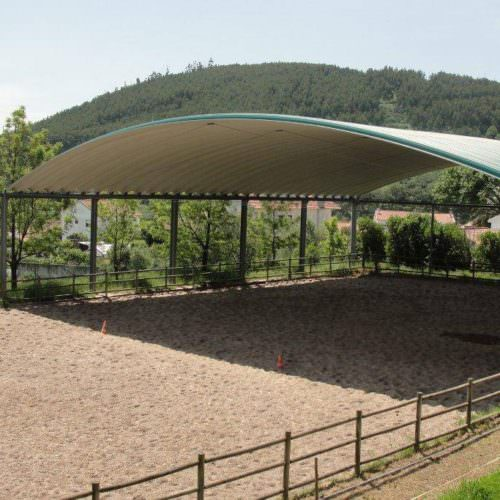The partially covered outdoor arena.