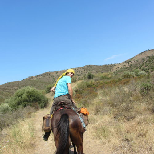 Adventurous trail riding holiday through the Pyrenees Mountains, Spain. Horse and rider.