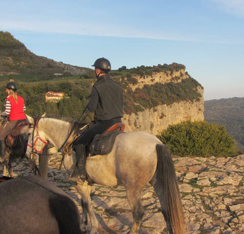 Riding holidays through the Pyrenees and coastal trails in Catalonia. Spain. Horses at sunset