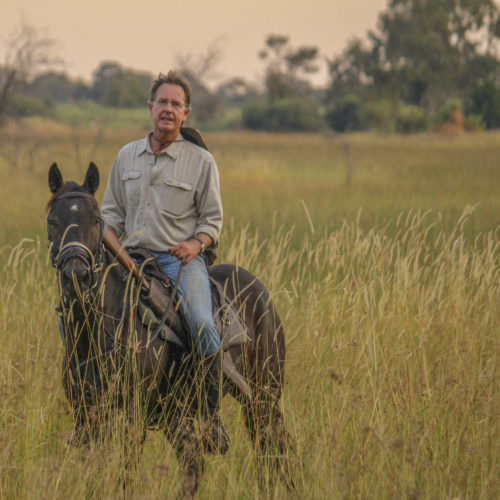 Mobile horseback safari in the Okavango Delta, Botswana. Horse and rider.
