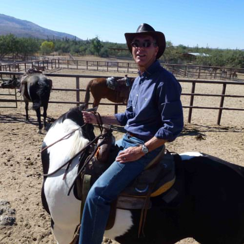 Western riding at Tanque Verde, Arizona. Coloured horse in western tack. In The Saddle guest photo.