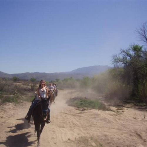 In The Saddle guests trail riding at Tanque Verde