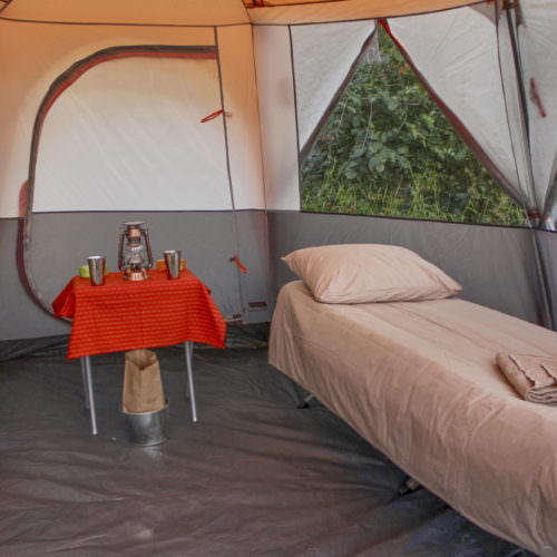 Mobile horseback safari in the Okavango Delta, Botswana. Bush camp tent and beds.
