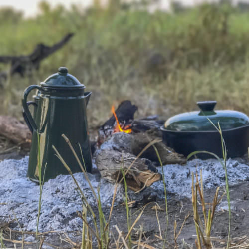 Mobile horseback safari in the Okavango Delta, Botswana. Bush camp coffee.