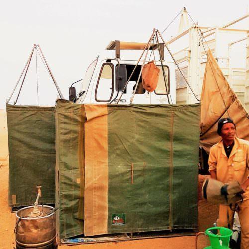 Bucket showers in the desert