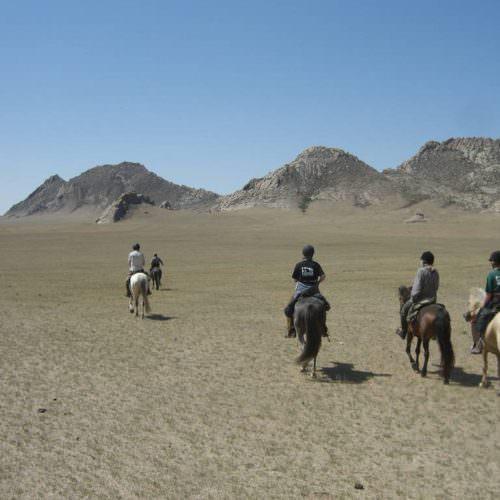 Mongolia riding in rocks