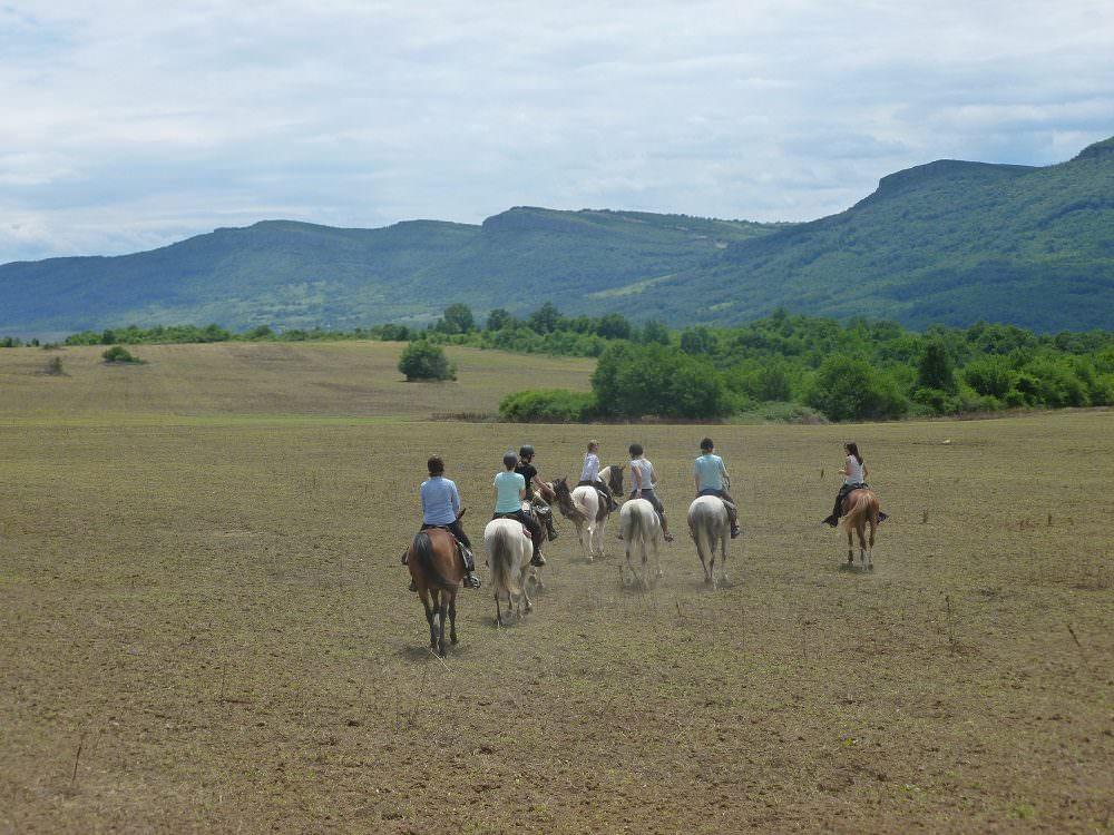 riding across farmland in Bulgaria